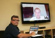 Shawn Davis and Ryan Stemkoski, on screen, demonstrate how Zipline employees use teleconferencing tools to collaborate on projects from remote locations.